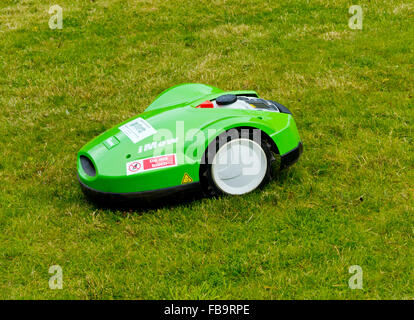 Viking Imow battery powered robotic lawn mower cutting grass using modern technology - Stock Photo