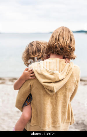 Sweden, Sodermanland, Stockholm Archipelago, Musko, Mother holding daughter (4-5) - Stock Photo