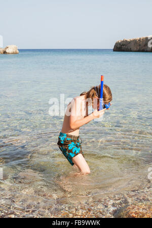 Greece, Karpathos, Amopi, Boy (8-9) looking at water - Stock Photo