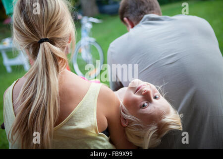 Sweden, Narke, Filipshyttan, Portrait of girls (6-7, 14-15) with father - Stock Photo