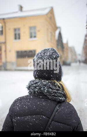 Sweden, Vastergotland, Gothenburg, Rear view of woman standing in street - Stock Photo