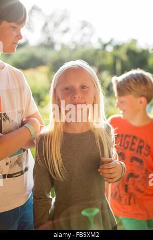 Sweden, Skane, Osterlen, Boy (12-13) standing next to sister ( 10-11) - Stock Photo