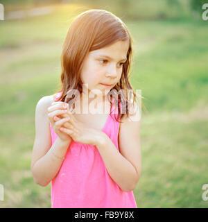 Sweden, Vastmanland, Girl (6-7) wearing pink top - Stock Photo
