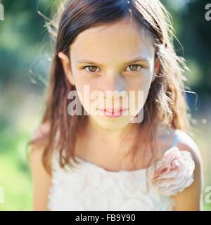 Sweden, Vastmanland, Girl (6-7) looking at camera Stock Photo