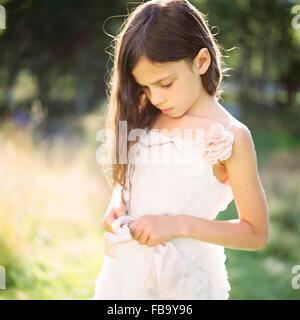 Sweden, Vastmanland, Portrait of girl (6-7) in white dress - Stock Photo