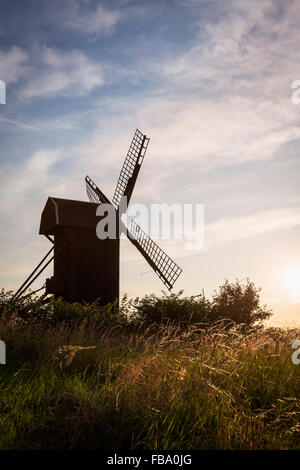Sweden, Skane, Silhouette of old windmill against sky - Stock Photo