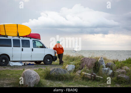 Sweden, Skane, Skanor med Falsterbo, Man looking at view - Stock Photo