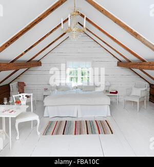 Sweden, Attic bedroom in rustic style - Stock Photo