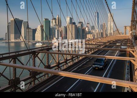 Brooklyn Bridge with Lower Manhattan skyline behind, New York, USA - Stock Photo