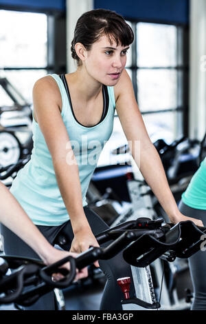 Fit woman working out at spinning class - Stock Photo