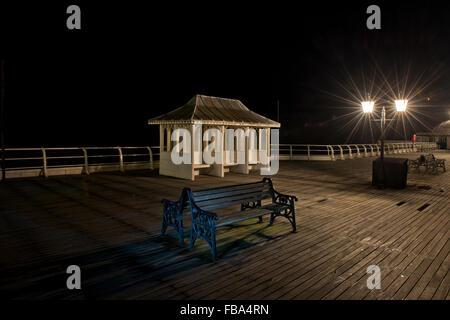 Night shot of Cromer Pier, Norfolk, UK - Stock Photo