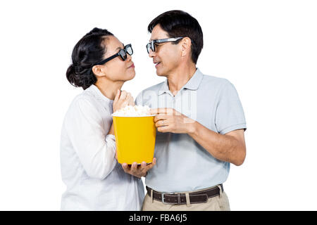 Couple watching a 3d movie - Stock Photo