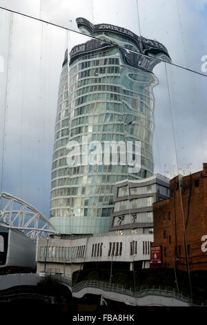 The Rotunda reflected in New Street Station building, Birmingham, UK - Stock Photo