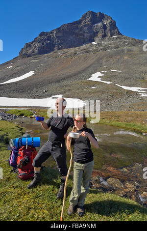 Sweden, Sarek National park, Pastavagge, Father and daughter (12-13 years) hiking in mountains - Stock Photo