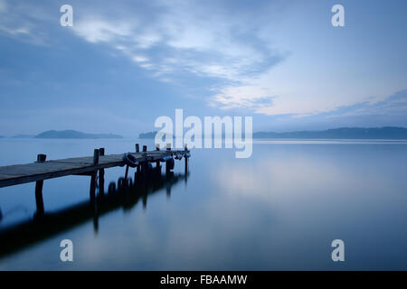 Sweden, Uppland, Stockholm Archipelago, Lidingo, Hoggarnsfjarden, Pier extending into calm bay - Stock Photo