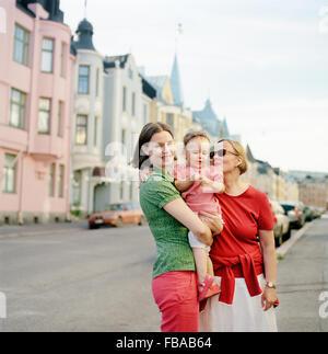 Finland, Uusimaa, Helsinki, Portrait of mother, grandmother and child (2-3) on street - Stock Photo