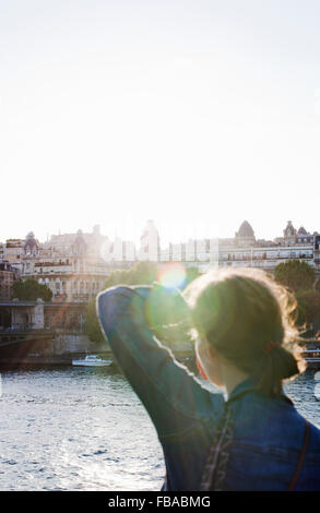 France, Ile-de-France, Paris, Rear view of woman in sunny day - Stock Photo
