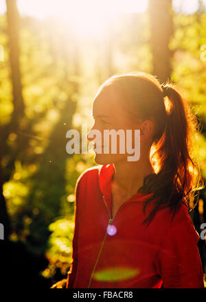 Finland, Paijat-Hame, Heinola, Mid-adult woman in forest - Stock Photo