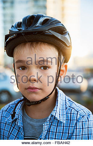 Australia, Portrait of young boy (6-7) in cycling helmet - Stock Photo