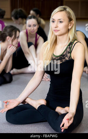 female friends in gym chatting after workout session