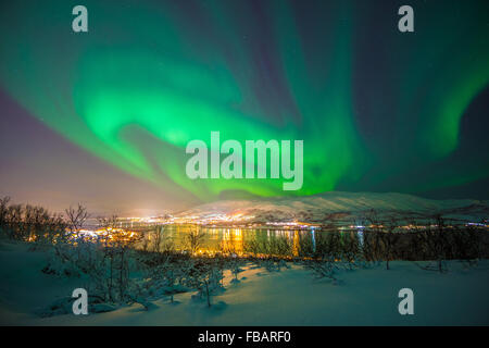 Aurora Borealis over Tromso, Northern Norway - Stock Photo