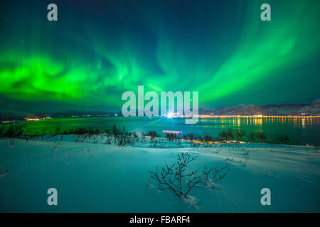 Aurora Borealis over Tromso, Northern Norway - Stock Photo