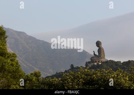 Giant Buddha in the Mountains of Lantau Island -  Hong Kong - Stock Photo
