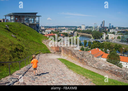 Remnants of the Upper Castle on Gediminas Hill and view of River Neris and new city, Vilnius, Lithuania - Stock Photo