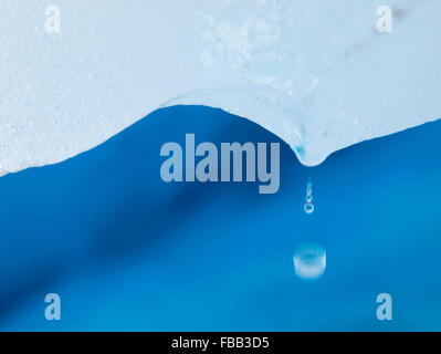 Water drops falling from glacial ice, Fox Glacier, New Zealand - Stock Photo