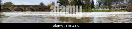 Bathampton Mill and weir with very high water level. A stretch of the River Avon on the outskirts of Bath, Somerset, - Stock Photo