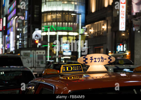 The Ginza in Tokyo at night - Stock Photo
