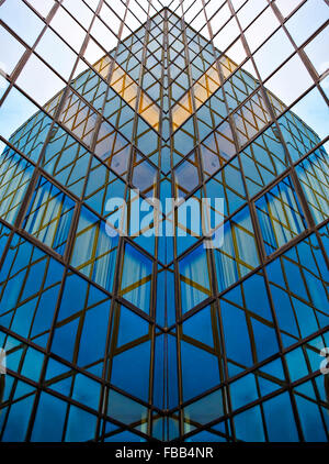 Glass walls of business center with reflections - Stock Photo