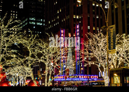 Low Angle View of the Radio City Music Hall Lit Up at Night During the Winter Holiday Season, Manhattan, New York - Stock Photo