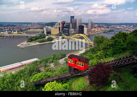Red Funicular  Car on a Hillside with Pittsburgh Downtown in the Background, Duquesne Incline, Mt Washington, Pittsburgh - Stock Photo