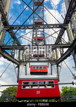 Low Angle View of Red Gondolas of the Viennese Giant Ferris Wheel, Prater Amusement Park Vienna, Austria - Stock Photo