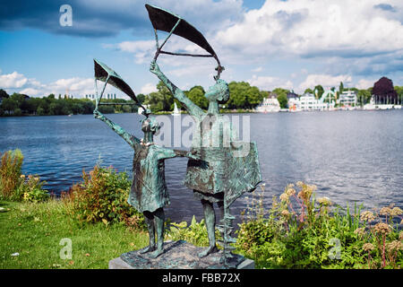Sculpture of Two Children with Kites along Alster Lake, Hamburg, Germany - Stock Photo