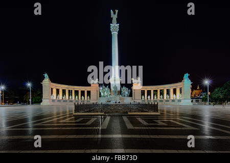 Low Angle View of the Hero's Square with the a Column and Colonnades, at Night, Budapest, Hungary - Stock Photo