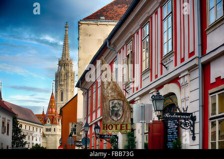 Low Angle View of a Street in the Castle District of Budapest with the Matthias Church in the Background, Hungary - Stock Photo