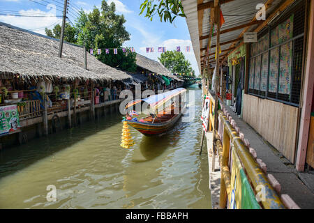 Longtail boat on the Thonburi Canal in Bangkok, Thailand - Stock Photo