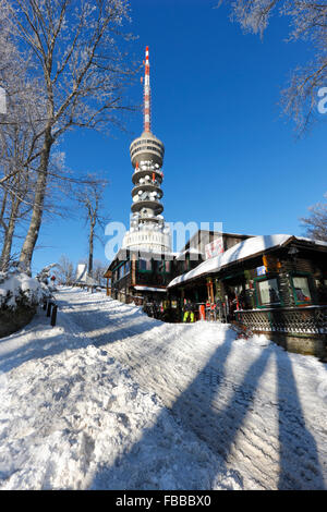 Sljeme mountain in winter. Television tower on Sljeme peak and Restourant in front - Stock Photo