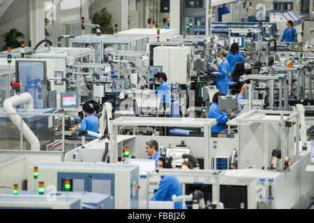 Employees Are Busy Working On The Production Lines At The