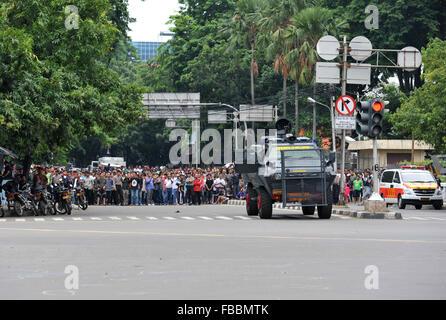 Jakarta, Indonesia. 14th Jan, 2016. People gather near the explosion site in Jakarta, Indonesia, Jan. 14, 2016. - Stock Photo