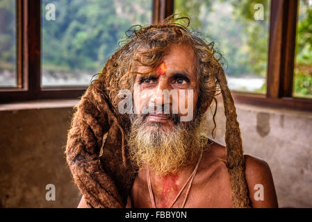Portrait of a Sadhu baba  (holy man) with traditional long hair in a nepalese temple - Stock Photo