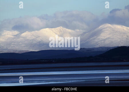 Cumbrian Fells, UK. 14th Jan, 2016. The people of Morecambe Bay awoke this morning to a fall of over night snow - Stock Photo