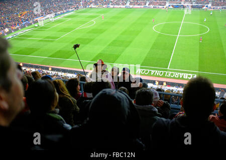 spectators do a 'selfie' photo at Camp Nou or Nou camp barcelona football stadium - Stock Photo