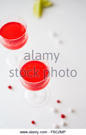 Cocktail served in a cranberry-rimmed glass - Stock Photo