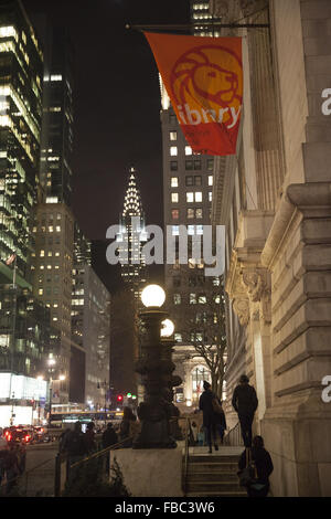 Looking east along 42nd St. from the the NY Public Library with the Chrysler building lit up in the background. - Stock Photo