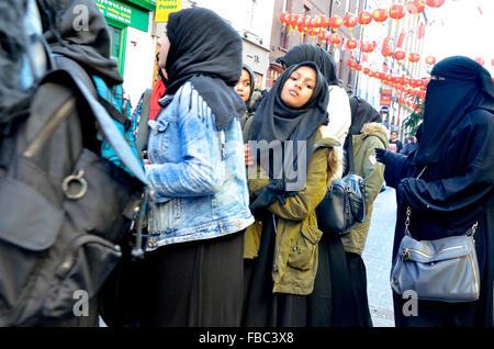 London, England, UK. School trip of young Muslim women in Chinatown - Stock Photo