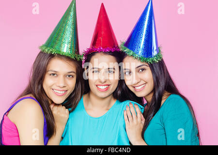 3 indian Young Womans friends Birthday Celebration - Stock Photo
