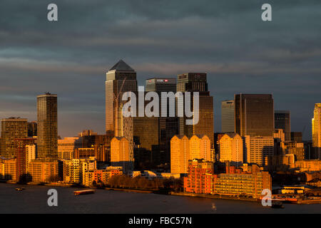 London, UK. 14th January, 2016. UK Weather: Evening sunset light over London, Canary Wharf business park buildings - Stock Photo